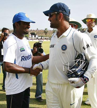 Murali with Dhoni
