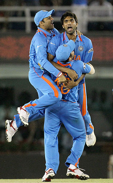 Munaf Patel (centre) celebrates a wicket with teammates