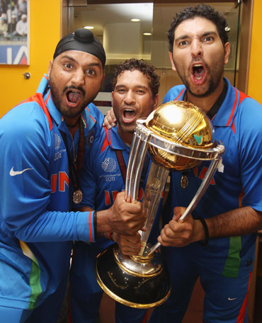 Harbhajan Singh (left),Sachin Tendulkar (centre) and Yuvraj Singh (right) celebrate in the players dressing room after winning the World Cup