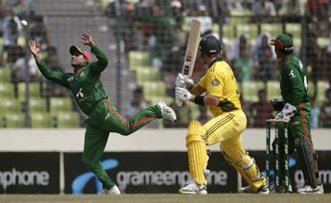 Bangladesh's Imrul Kayes (L) jumps to catch a ball, as Watson watches