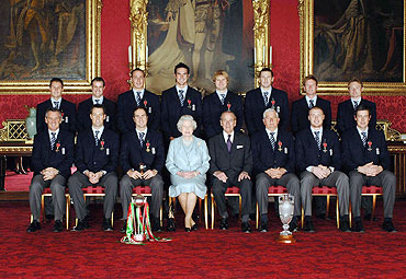 Members of England's 2005 Ashes winning Cricket team and coach Duncan Fletcher (3rd from right) Queen Elizabeth II (4th from L) and the Duke of Edinburgh (4th from R) in Buckingham Palace in London at an investiture ceremony