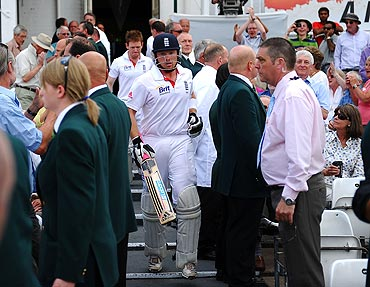 Ian Bell makes his way out of the dressing room after the tea break, following his reinstatement after being given run out