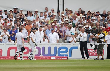 Reserve Umpire Tim Robinson tells Ian Bell and Eoin Morgan not to leave the field after the former was controversially run out