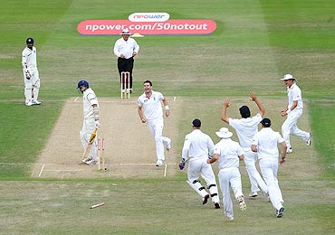 England players celebrate after the dismissal of VVS Laxman on Monday