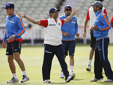 India's Sachin Tendulkar shares a light moment with teammates during a training session at Edgbaston