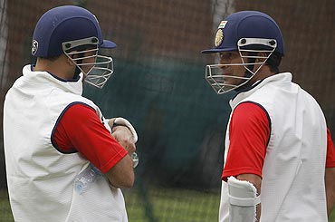 Sachin Tendulkar and Virender Sehwag chat during a training session