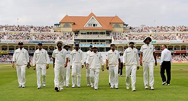 Indian players leave the field