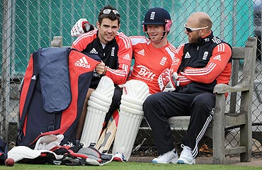James Anderson, Eoin Morgan and Matt Prior take a break during a nets session