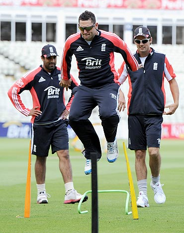 Tim Bresnan goes through the grind as Ravi Bopara and Alastair Cook watch during a nets session