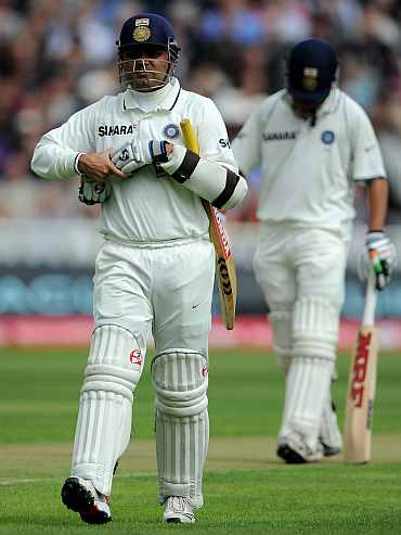 Virender Sehwag walks back to the pavillion after being dismissed