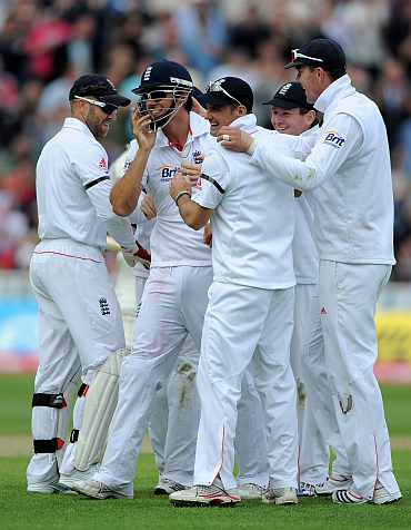 England players celebrate after picking up the wicket out Ishant Sharma