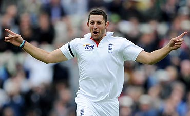 Tim Bresnan of England celebrates taking the wicket of Rahul Dravid