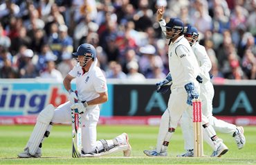 Dhoni celebrates as Strauss is bowled by Mishra (not in pic)