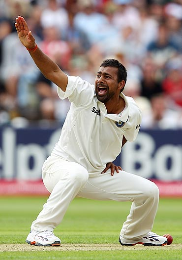 Praveen Kumar appeals successfully for the wicket of Kevin Pietersen