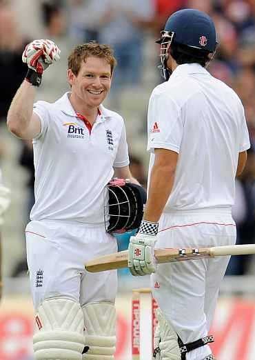 Eoin Morgan celebrates after scoring a century