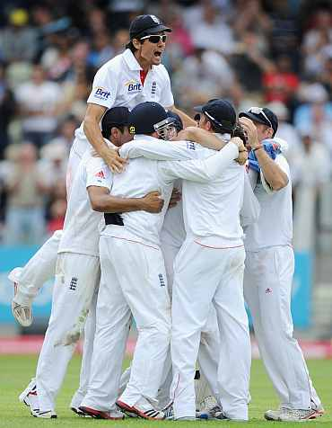 James Anderson celebrates after picking the wicket of VVS Laxman