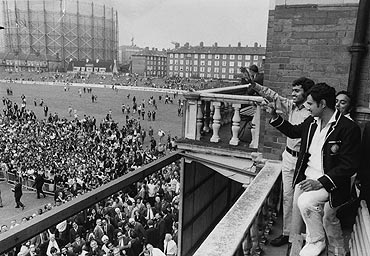India skipper Ajit Wadekar and teammate B S Chandraserhar wave to cheering crowds at The Oval after India won the Test series against England in August 1971