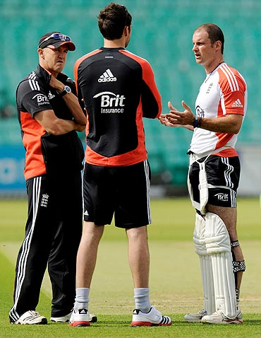 England's coach Andy Flower (left) and captain Andrew Strauss (right) speak with James Anderson during a nets session