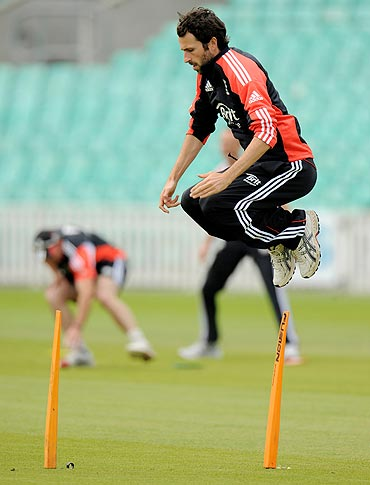 England's Graham Onions leaps during a training session