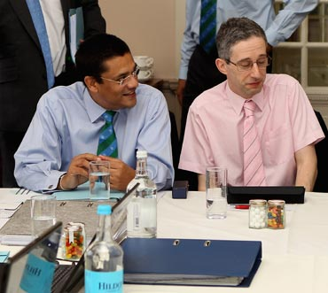 ICC Chief match referee Ranjan Madugalle (left) with cricket statistician David Kendix