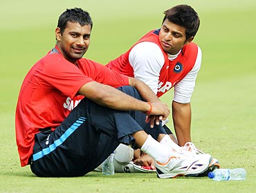 Praveen Kumar (left) and Suresh Raina take a break during a nets session at The Oval on Wednesday