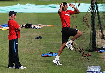 Ishant Sharma (right) bowls in the nets as coach, Duncan Fletcher watches