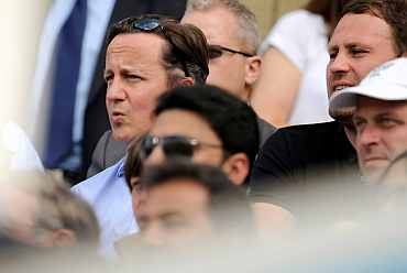 Britain's PM Cameron watches the action on Day 2
