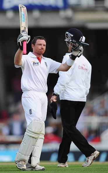 Ian Bell celebrates after the century