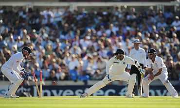 Virender Sehwag is clean bowled by Graeme Swann