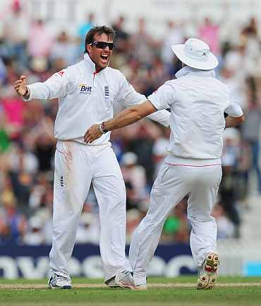Graeme Swann celebrates after picking up a wicket