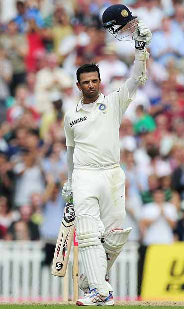 Rahul Dravid celebrates after scoring his century