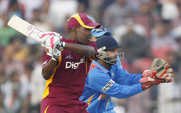 West Indies' Darren Bravo (left) hits a shot as India's wicketkeeper Parthiv Patel fields during their first one-dayer