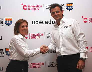 Former Australian cricketer Adam Gilchrist with Professor Judy Raper, Deputy Vice Chancellor (research) UOW
