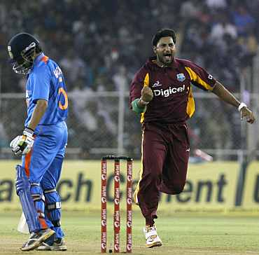 Ravi Rampaul celebrates after picking up the wicket of Gautam Gambhir