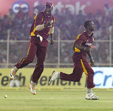 Darren Sammy (left) celebrates with Kemar Roach after winning the 3rd ODI