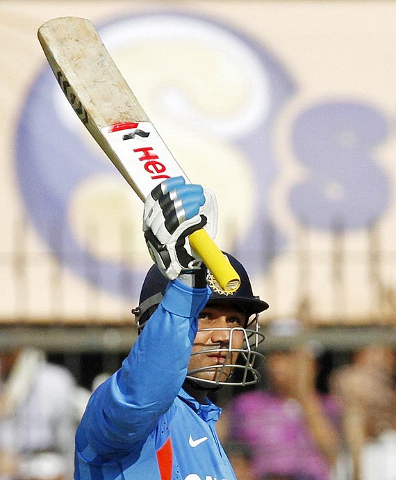 Sehwag brought up his half century with a huge six