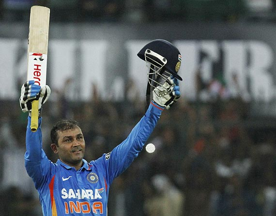 Virender Sehwag celebrates on completing his double century against West Indies on Thursday