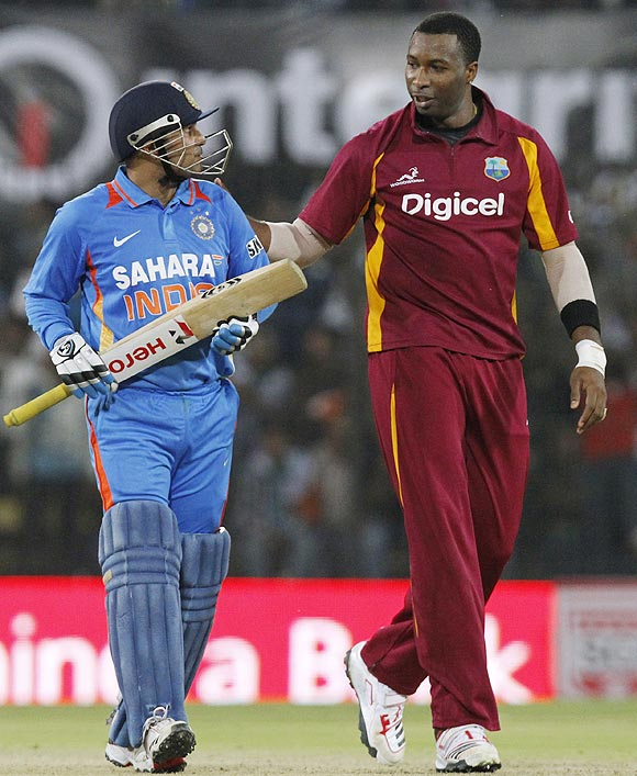 India's captain Virender Sehwag (left) is congratulated by West Indies' Kieron Pollard after scoring 200 runs