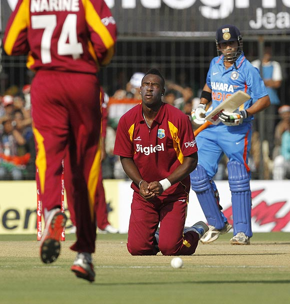 West Indies's Andre Russell reacts after dropping a catch off the bat of India's Gautam Gambhir