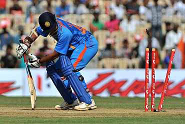 Parthiv Patel is clean bowled by Kemar Roach
