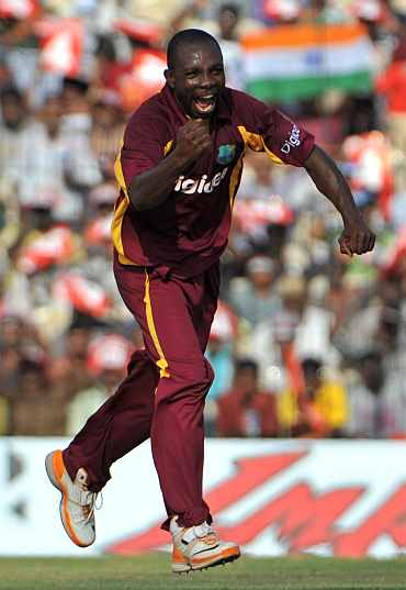 Anthony Martins celebrates after picking the wicket of Gautam Gambhir
