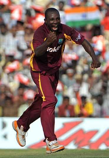 Anthony Martins celebrates after picking the wicket of Gautam Gambhir