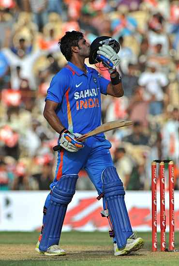 Manoj Tiwary reacts after reaching his century