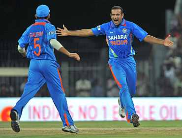 Irfan Pathan celebrates after picking the wicket of Lendl Simmons