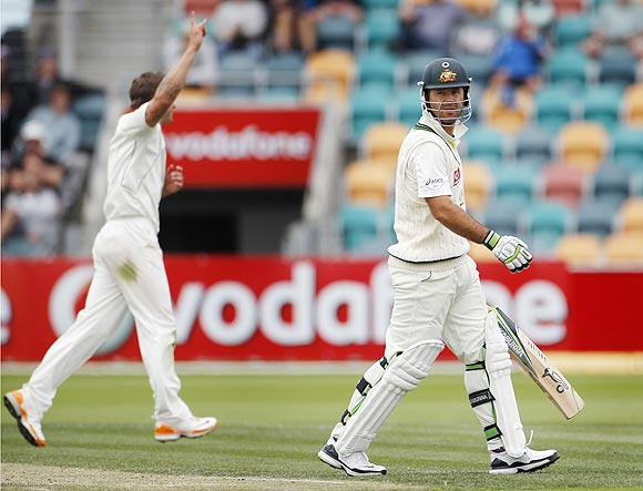 Australia's Ricky Ponting (right) leaves the field as New Zealand's Doug Bracewell celebrates