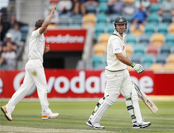 Australia's Ricky Ponting (right) leaves the field as New Zealand's Doug Bracewell celebrates