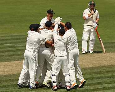 New Zealand players celebrate after winning the