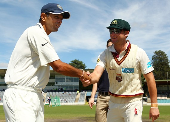 Rahul Dravid and Ryan Broad of the Cricket Australia Chairman's XI shake hands after the coin toss.