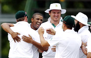 Vernon Philander celebrates with teammates