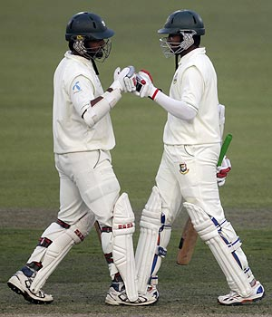 Bangladesh's Shahriar Nafees (left) congratulates teammate Shakib Al Hasan after he scored a century against Pakistan on Saturday